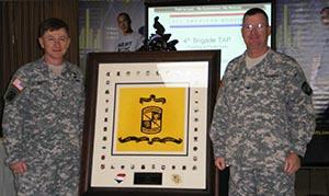 Maj. Gen. Arthur Bartell presenta a plaque to 4th brigade Commander Col. Ronald Eldrod